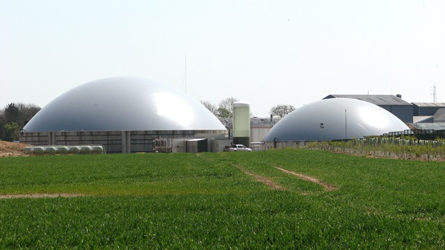 Domed structures in a field that house anaerobic digesters.